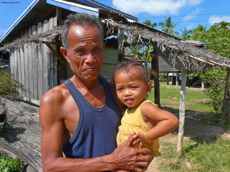 I took this picture in the 4000 Islands in Laos. I was just wandering around, checking out the island, when this man waved me over. He didn't speak any English, but he kept pointing to my camera and to the little girl he's holding, who I assume was his granddaughter. I took a picture and showed them the screen, and they both smiled when they saw it. The people of Laos have been through so much, but they were all still so happy despite everything.