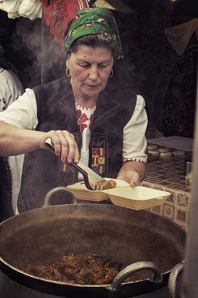 The line for cabbage rolls was long at this market in Bucharest, Romania, but they were worth the wait. This lady served out dozens of portions while I watched her from our spot in line, never once pausing to take a break from the hot steam escaping the boiling pot. While her traditional clothing does well to represent her nation, it's nothing compared to her cooking!