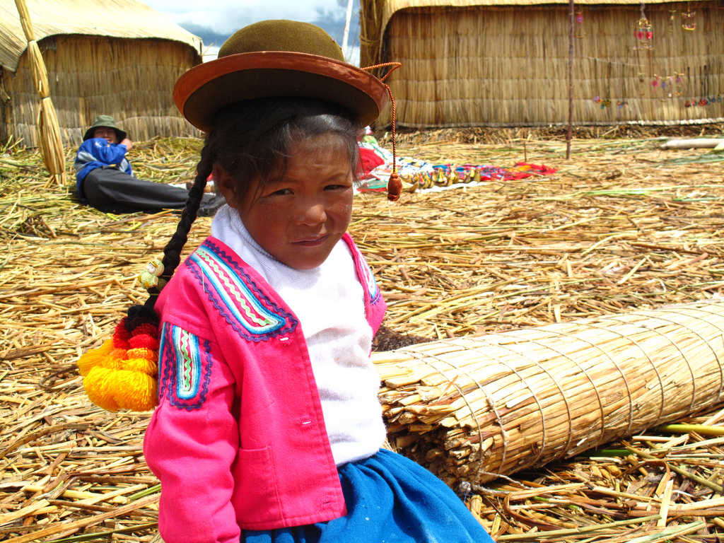 This photo was captured on the floating reed islands of Lake Titicaca in southern Peru. What I like most about this photo is the unimpressed look she's giving. It's a touristy island, so you can imagine how people want to take her photo every day. She was very curious and thrilled when I showed he the photo afterwards.