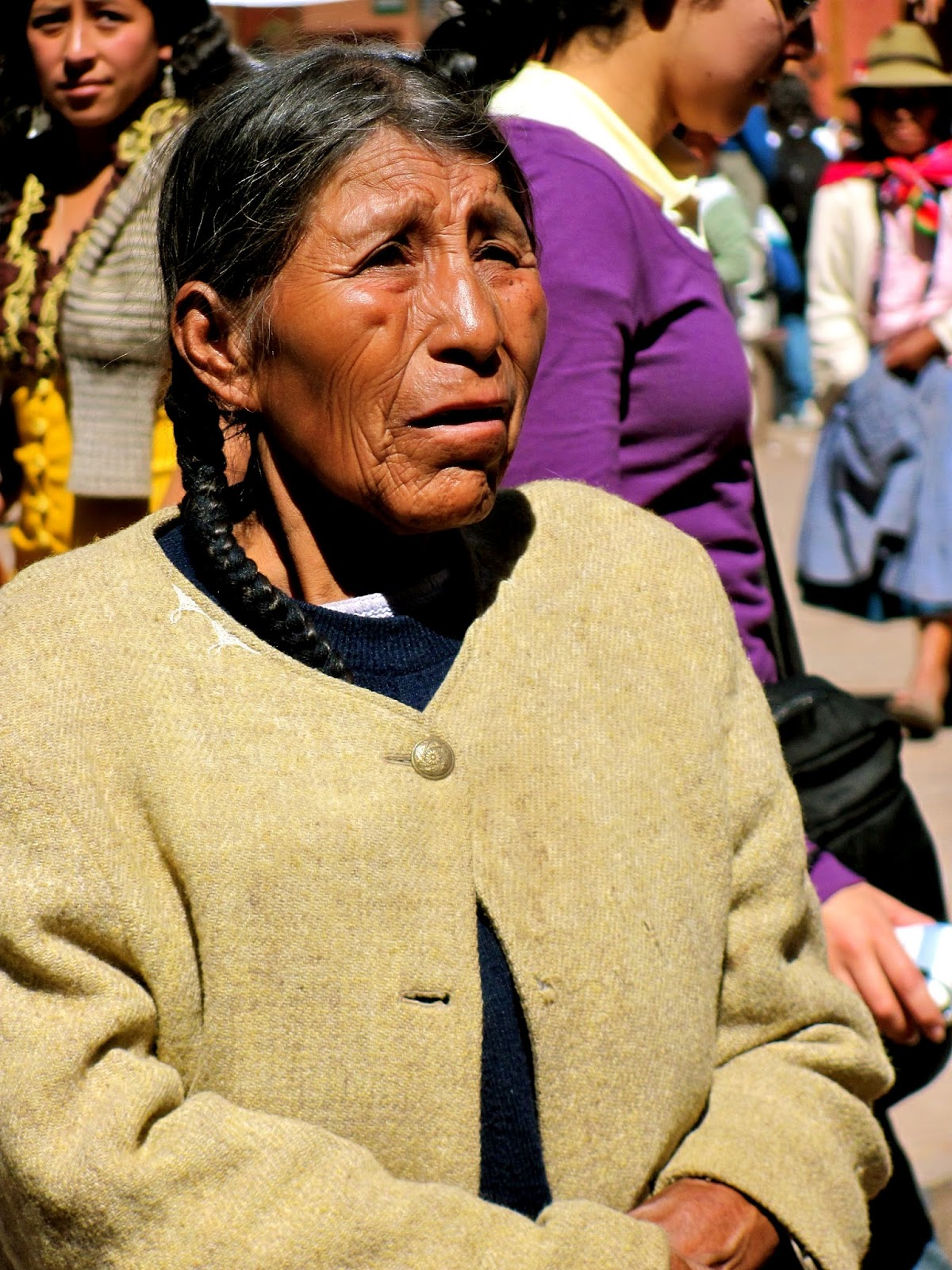 This woman was photographed in Pisac, Peru during the Fiesta de la Virgin de la Carmen. She looks like she has the map of the world etched upon her skin, with the worries of her entire people shadowed within her eyes. I took so many photographs of the warm, gentle, gracious people of Peru on my journey there, and still looking back through photographs, they are some of my favorites ever  taken.