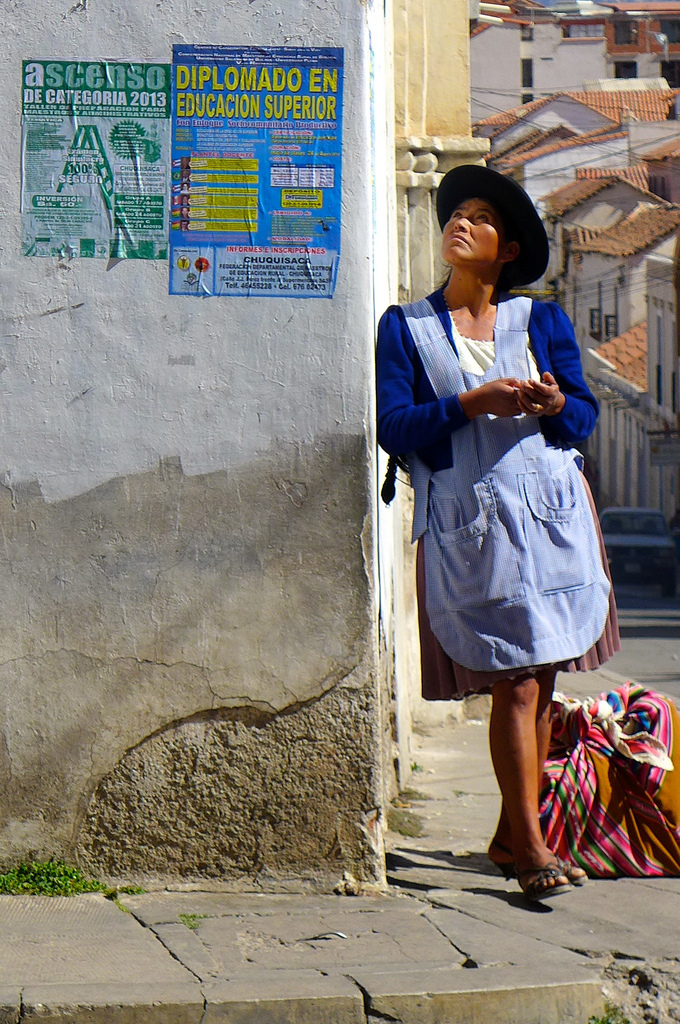 My shot was taken in Sucre, Bolivia. I always have my camera within easy access when wandering the streets and as soon as I saw this gorgeous girl in traditional clothing I knew I had to get a shot. She turned her head just as the shutter clicked and it remains my favourite portrait of our whole trip.