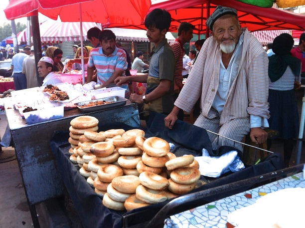 A man sells fresh bagels at a street market in Kashgar, Xinjiang, China.