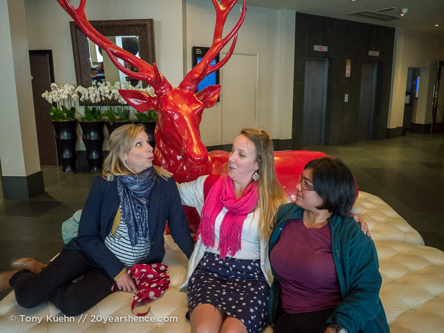 Kat, Maddy & Steph with a giant red stag at the Radisson Blu